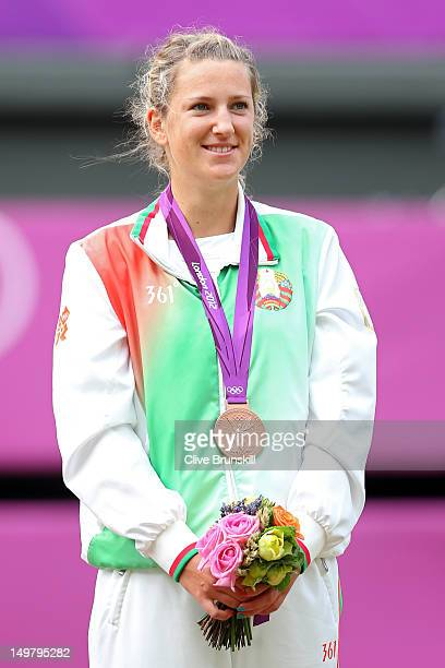 Bronze medalist Victoria Azarenka of Belarus pose on the podium during the medal ceremony after the gold medal match of the Women's Singles Tennis on...