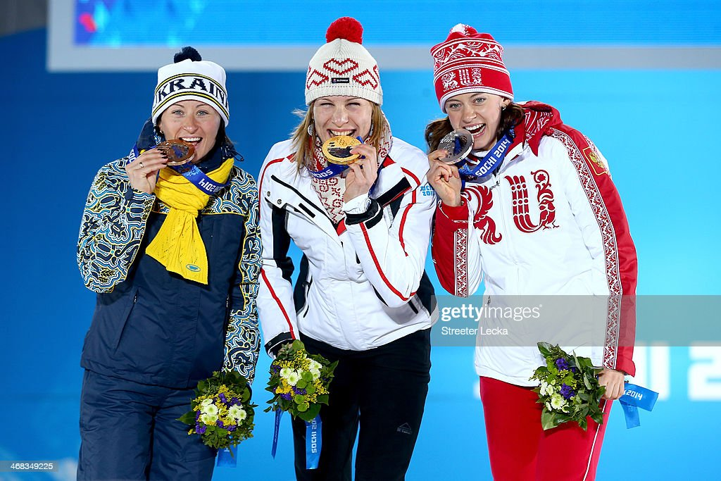 Bronze medalist Vita Semerenko of Ukraine, gold medalist Anastasiya Kuzmina of Slovakia and silver medalist Olga Vilukhina of Russia celebrate during the medal ceremony for the Biathlon Women's 7.5 km Sprint on day 3 of the Sochi 2014 Winter Olympics at Medals Plaza in the Olympic Park on February 10, 2014 in Sochi, Russia.