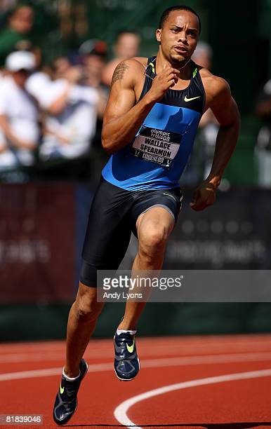 Bronze medalist Wallace Spearmon competes in the men's 200 meter finals during day eight of the US Track and Field Olympic Trials at Hayward Field on...