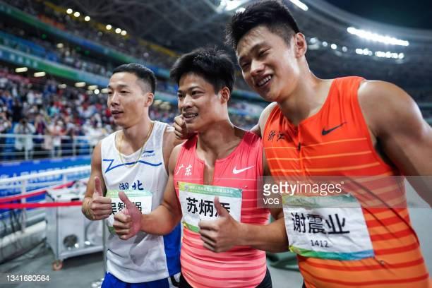 Bronze medalist Wu Zhiqiang of Hubei, gold medalist Su Bingtian of Guangdong and silver medalist Xie Zhenye of Zhejiang celebrate after the Men's...