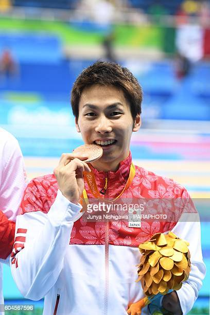 Bronze medalist YAMADA Takuro of JAPAN celebrates on the podium at the medal ceremony for the Men's 50m Freestyle S9 Final on day 6 of the Rio 2016...