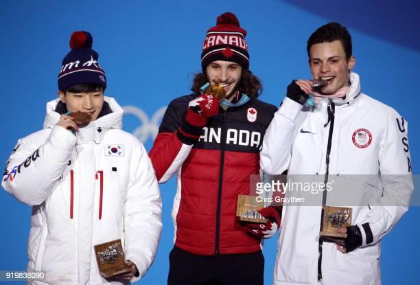 Bronze medalist Yira Seo of Korea gold medalist Samuel Girard of Canada and silver medalist JohnHenry Krueger of the United States celebrate during...