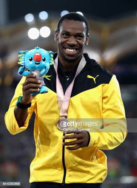 Bronze medalist Yohan Blake of Jamaica celebrates during the medal ceremony for the Men's 100 metres during the Athletics on day six of the Gold...