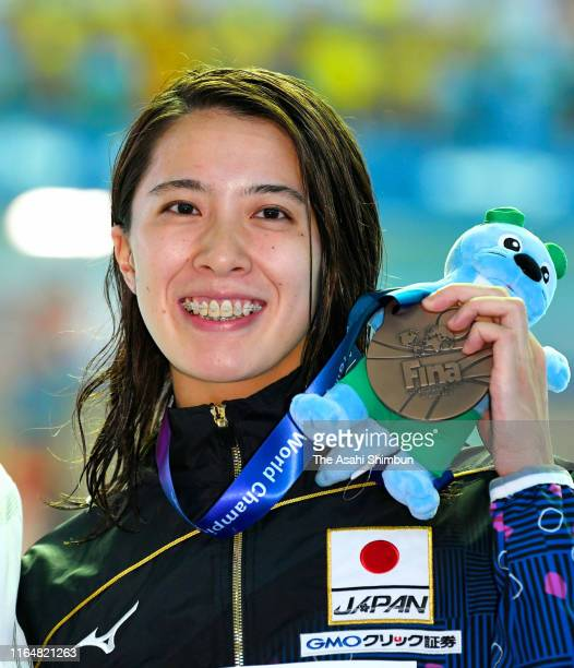 Bronze medalist Yui Ohashi of Japan celebrates after the medal ceremony for the Women's Individual Medley on day eight of the Gwangju 2019 FINA World...