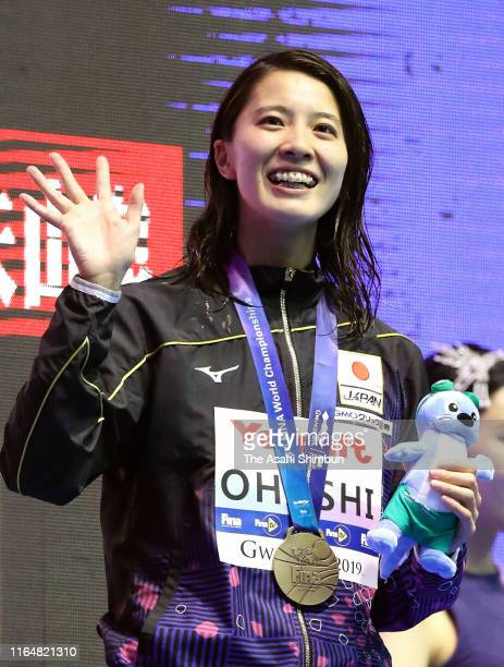 Bronze medalist Yui Ohashi of Japan celebrates on the podium at the medal ceremony for the Women's Individual Medley on day eight of the Gwangju 2019...