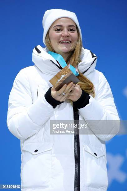 Bronze medalist Yulia Belorukova of Olympic Athlete from Russia poses during the medal ceremony for the CrossCountry Ladies' Sprint Classic on day...