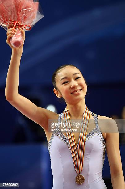 Bronze medalist YuNa Kim of South Korea poses after the medals ceremony during the women's Free Skating program at the World Figure Skating...
