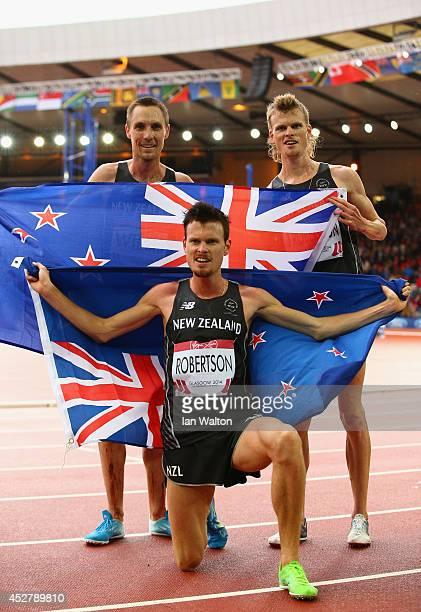 Bronze medalist Zane Robertson of New Zealand celebrates with Jake Robertson of New Zealand and Nick Willis of New Zealand after the Men's 5000...