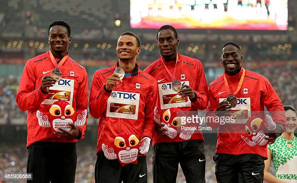 Bronze medalists Aaron Brown of Canada Andre De Grasse of Canada Brendon Rodney of Canada and Justyn Warner of Canada pose on the podium during the...