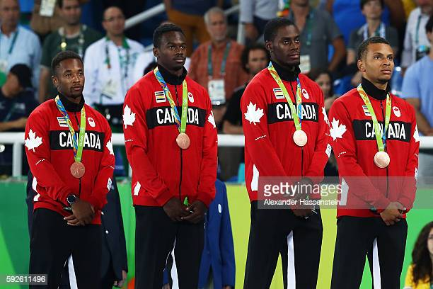 Bronze medalists Akeem Haynes Aaron Brown Brendon Rodney and Andre de Grasse of Canada stand on the podium during the medal ceremony for the Men's 4...