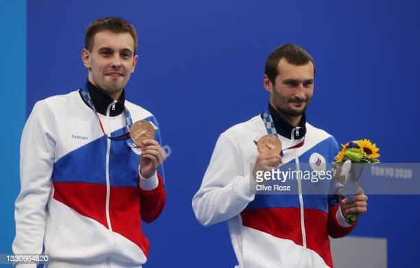 Bronze medalists Aleksandr Bondar and Viktor Minibaev of Team Russian Olympic pose during the medal presentation for the Men's Synchronised 10m...