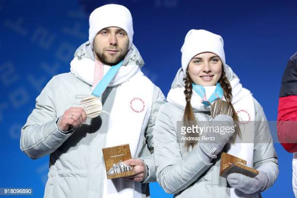 Bronze medalists Aleksandr Krushelnitckii and Anastasia Bryzgalova of Olympic Athletes from Russia pose during the medal ceremony for Curling Mixed...