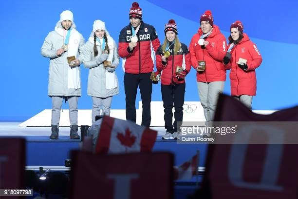 Bronze medalists Aleksandr Krushelnitckii and Anastasia Bryzgalova of Olympic Athletes from Russia gold medalists John Morris and Kaitlyn Lawes of...