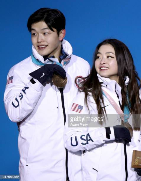 Bronze medalists Alex Shibutani and Maia Shibutani of the United States pose with their teammates during the victory ceremony after the Figure...