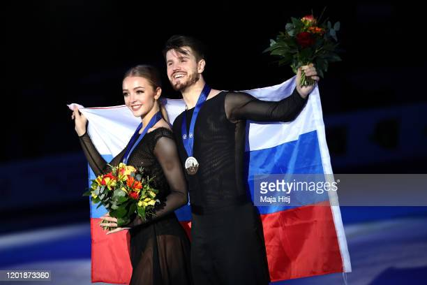 Bronze medalists Alexandra Stepanova and Ivan Bukin of Russia pose for a photo after the pairs competition during the ISU European Figure Skating...
