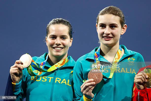 Bronze medalists Anabelle Smith and Maddison Keeney of Australia pose on the podium during the medal ceremony for the Women's Diving Synchronised 3m...