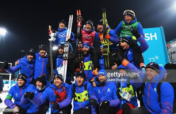 Bronze medalists Anais Bescond Anais Chevalier Justine Braisaz and Marie Dorin Habert of France celebrate with team mates and coaches after the...