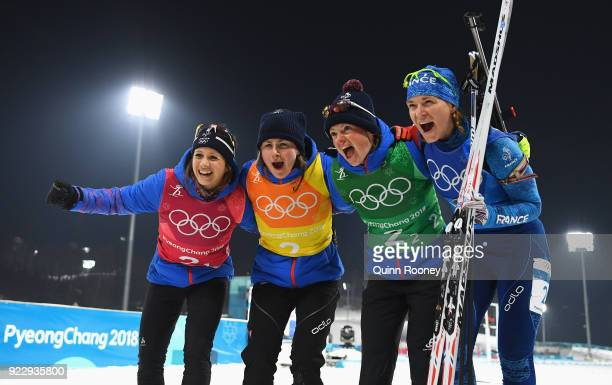 Bronze medalists Anais Chevalier Justine Braisaz Mona Brorsson and Anais Bescond of France celebrate after the Women's 4x6km Relay on day 13 of the...