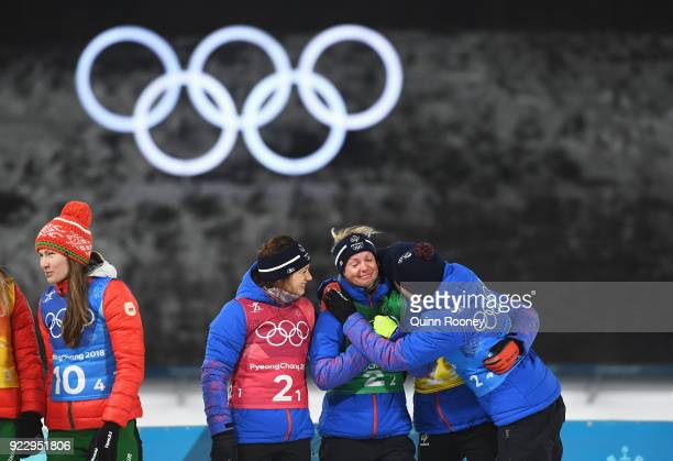 Bronze medalists Anais Chevalier Marie Dorin Habert Justine Braisaz and Anais Bescond of France of France celebrate on the podium during the victory...