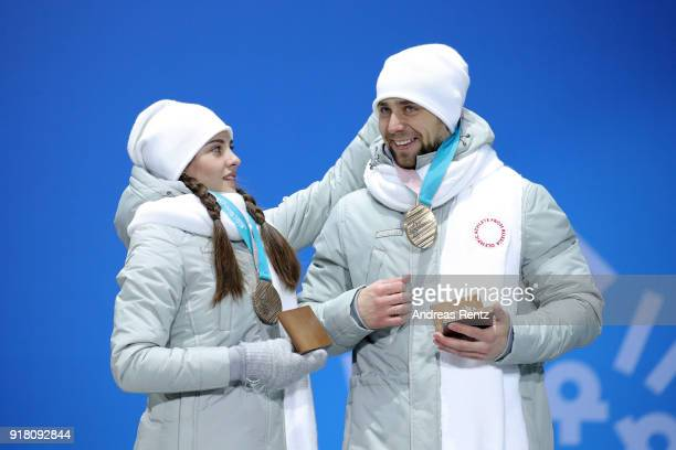 Bronze medalists Anastasia Bryzgalova and Aleksandr Krushelnitckii of Olympic Athletes from Russia pose during the medal ceremony for Curling Mixed...