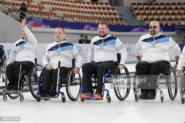Bronze medalists Angie Malone Robert McPherson Hugh Nibloe and Gregor Ewan from Scotland celebrate in the medal ceremony for the World Wheelchair...