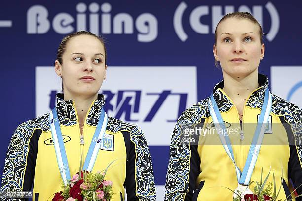 Bronze medalists Anna Pysmenska and Olena Fedorova of Ukraine pose after the Women's 3m Springboard Synchro Final during day one of the FINA Diving...
