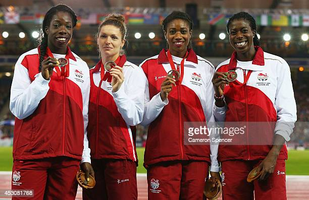 Bronze medalists Anyika Onuora Kelly Massey Shana Cox and Christine Ohuruogu of England on the podium during the medal ceremony for the Women's 4x400...