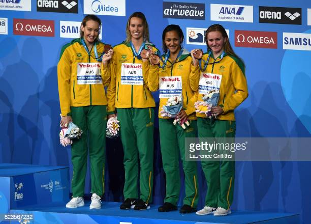 Bronze medalists Australia pose with the medals won during the Womens 4x200m Freestyle final on day fourteen of the Budapest 2017 FINA World...