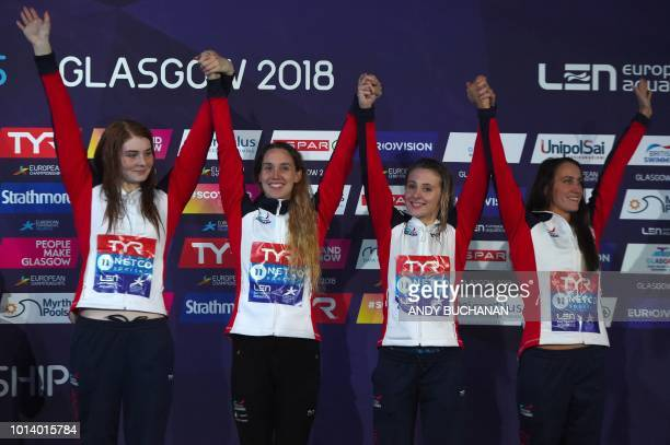 Bronze medalists Britain's Georgia Davies Britain's SiobhanMarie O'Connor Britain's Alys Thomas and Britain's Freya Anderson pose on the podium...