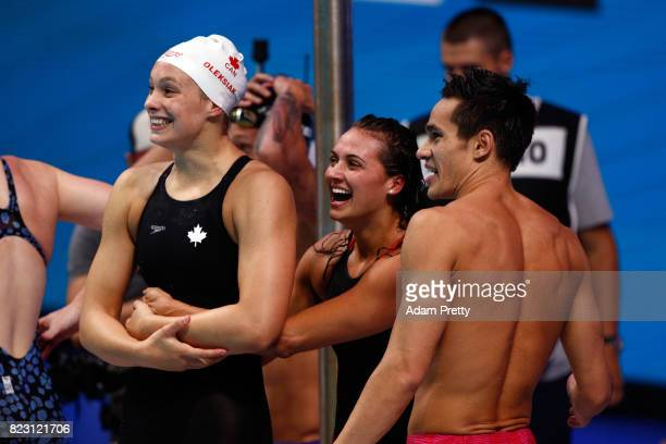 Bronze medalists Canada celebrate winning the bronze medal during the Mixed 4x100m Medley Relay final on day thirteen of the Budapest 2017 FINA World...