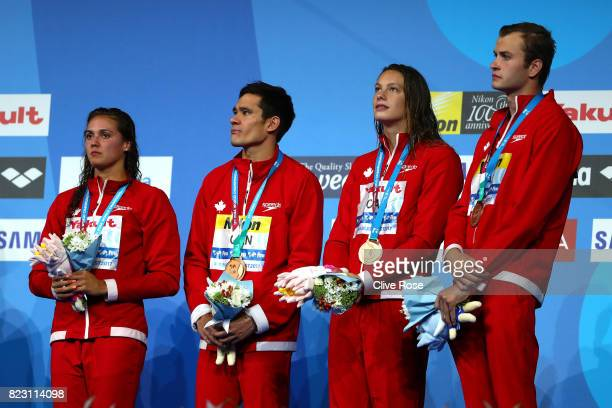 Bronze medalists Canada pose with the medals won during the Mixed 4x100m Medley Relay final on day thirteen of the Budapest 2017 FINA World...
