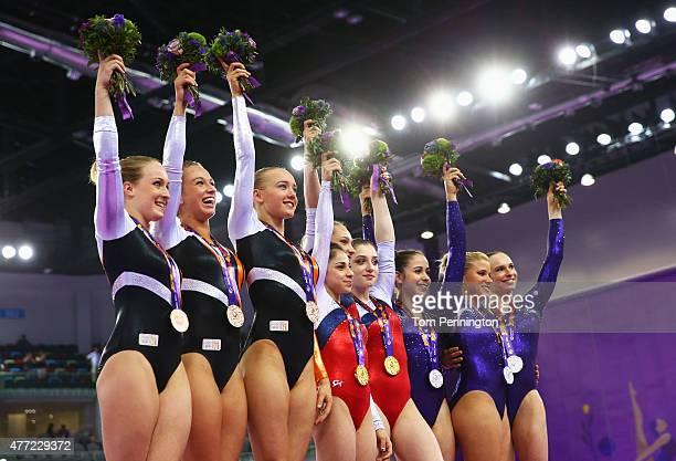 Bronze medalists Celine van Gerner Lisa Top and Lieke Wevers of the Netherlands gold medalists Seda Tutkhalyan Victoria Komova and Aliya Mustafina of...