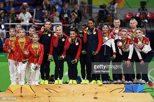 Bronze medalists China gold medalist United States and silver medalists Russia pose for photographs on the podium at the medal ceremony for the...