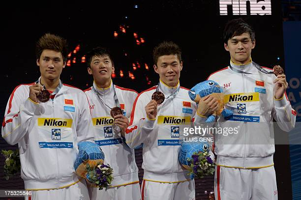 Bronze medalists China's Sun Yang Hao Yun Li Yunqi and Wang Shun pose on the podium during the award ceremony of the men's 4x200metre freestyle relay...