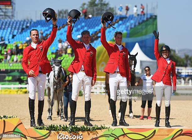Bronze medalists Christian Ahlmann of Germany riding Taloubet Z, Ludger Beerbaum of Germany riding Casello, Daniel Deusser of Germany riding First...