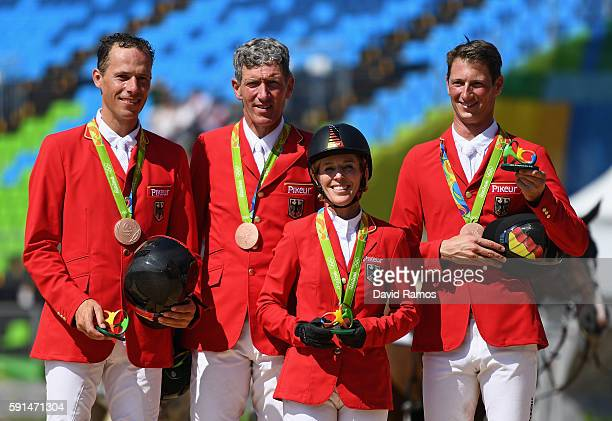 Bronze medalists Christian Ahlmann of Germany riding Taloubet Z, Ludger Beerbaum of Germany riding Casello, Meredith Michaels-Beerbaum of Germany...