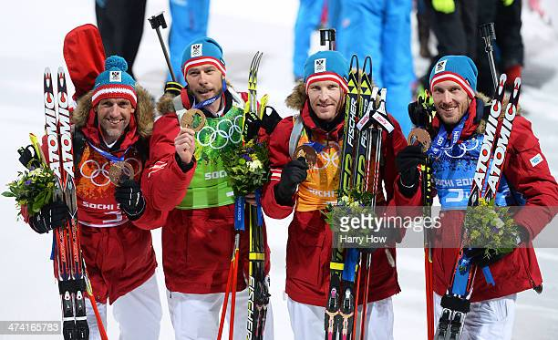 Bronze medalists Christoph Sumann Daniel Mesotitsch Simon Eder and Dominik Landertinger of Austria celebrate after the medal ceremony for the Men's 4...