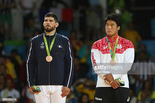 Bronze medalists Cyrille Maret of France and Ryunosuke Haga of Japan celebrate on the podium after the men's 100kg bronze medal judo contests on Day...