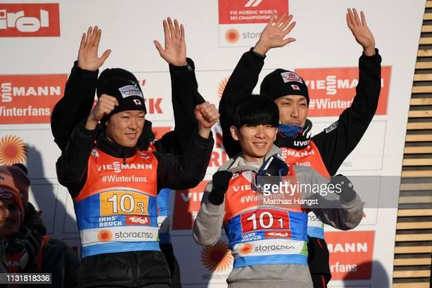 Bronze medalists Daiki Ito Ryoyu Kobayashi Junshiro Kobayashi and Yukiya Sato of Japan celebrates during the flower ceremony for the Men's Team Ski...