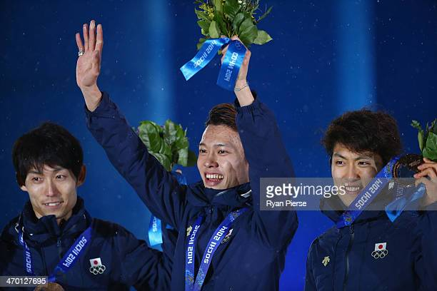 Bronze medalists Daiki Ito, Taku Takeuchi and Reruhi Shimizui of Japan celebrate during the medal ceremony for the Men's Team Ski Jumping on day 11...