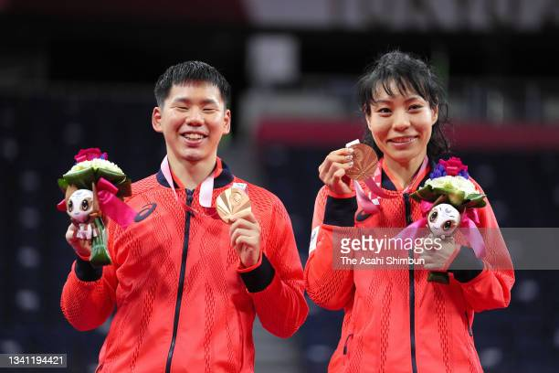 Bronze medalists Daisuke Fujihara and Akiko Sugino of Team Japan pose on the podium at the medal ceremony for the Badminton Mixed Doubles SL3-SU5 on...
