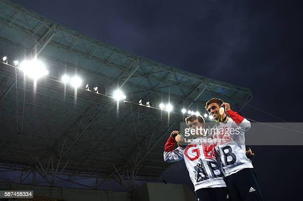 Bronze medalists Daniel Goodfellow and Tom Daley of Great Britain celebrate on the podium during the medal ceremony for the Men's Diving Synchronised...