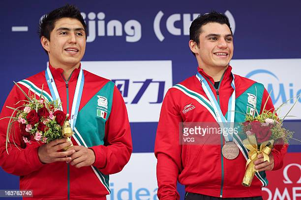 Bronze medalists Daniel Islas and Yahel Castillo Huerta of Mexico pose after the Men's 3m Springboard Synchro Final during day one of the FINA Diving...