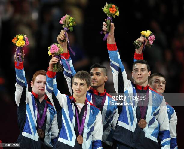 Bronze medalists Daniel Purvis Max Whitlock Louis Smith Kristian Thomas and Sam Oldham of Great Britain celebrate on the podium during the medal...