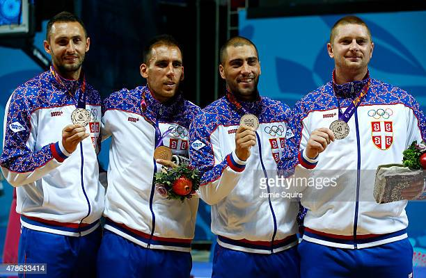 Bronze medalists Dejan Majstorovic Marko Zdero Dusan DomovicBulut and Marko Savic of Serbia stand on the podium during the medal ceremony for the...