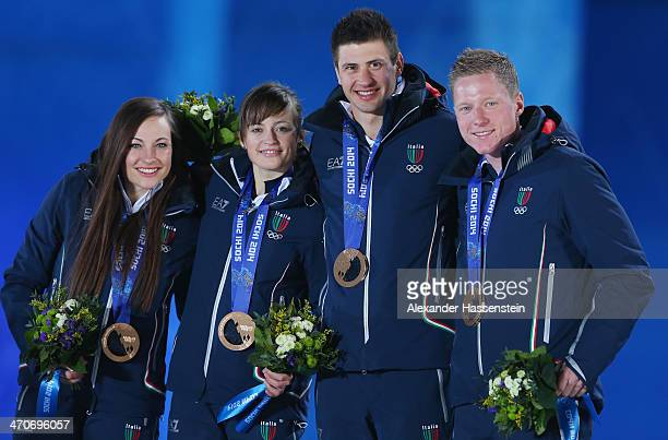 Bronze medalists Dorothea Wierer Karin Oberhofer Dominik Windisch and Lukas Hofer of Italy celebrate during the medal ceremony for the 2 x 6 km Women...