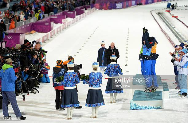 Bronze medalists Dorothea Wierer of Italy Karin Oberhofer of Italy Dominik Windisch of Italy and Lukas Hofer of Italy celebrate during the flower...
