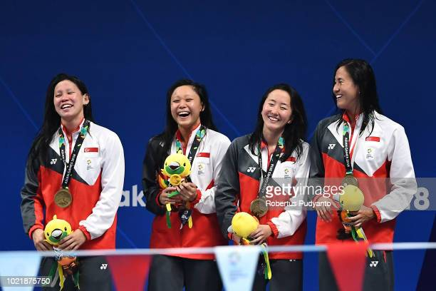 Bronze medalists En Qi Hoong Samantha Louisa Ginn Jing Wen Quah and Ting Wen Quah of Singapore celebrate victory during Women's 4x100m Medley Relay...