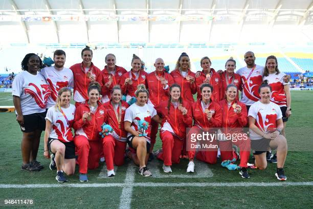 Bronze medalists England pose during the medal ceremony for the Women's Gold Medal Rugby Sevens Match between Australia and New Zealand on day 11 of...
