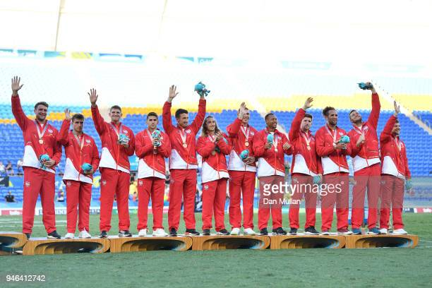 Bronze medalists England pose during the medal ceremony for the Men's Gold Medal Rugby Sevens Match between Fiji and New Zealand on day 11 of the...